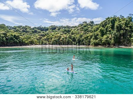 Manuel Antonio Costa Rica 02.11.2019 Sup Stand Up Paddle Boarding In Blue Bay With Empty Beach Centr