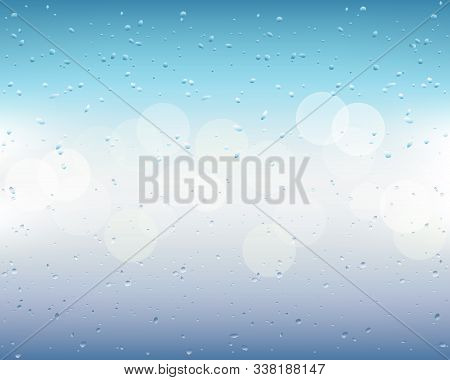 Drops And Trickles Of Water On The Glass. Raindrops On A Blurred Window Background With Bokeh. Blue