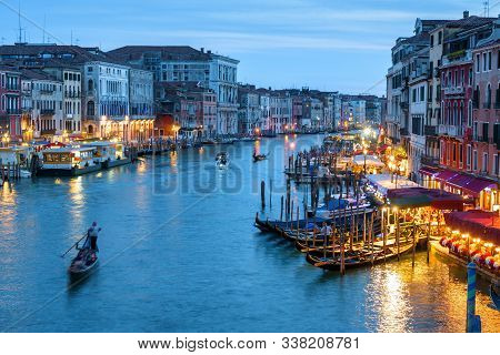 Venice At Night, Italy. Scenery Of The Grand Canal In Evening. Nightlife In Waterfronts Of Venice In