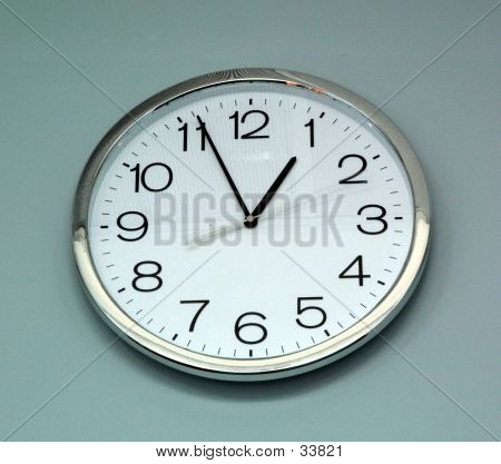 Analogue Clock On A Blue Background