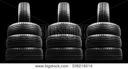 Car Tire Isolated On Black Background. Tire Stack. Car Tyre Protector Close Up. Black Rubber Tire. B