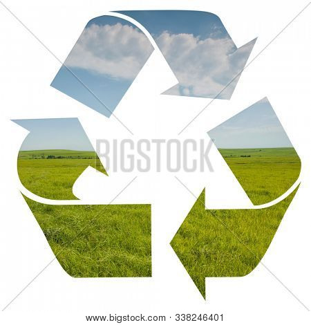 Recycling logo isolated on white, with an image of spring prairie with sky; concept of clean water and air recycled in nature