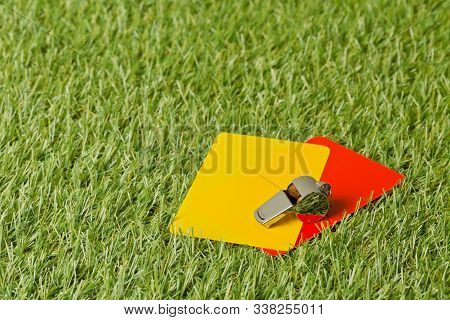 Soccer Sports Referee Yellow And Red Cards With Chrome Whistle On Grass Background - Penalty, Foul O