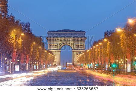 The Famous Triumphal Arch And Champs Elysees Avenue, Paris.