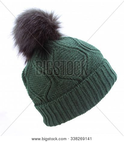 Green Woolen Winter Cap Hat With A Pom Pom Pompon Isolated On White