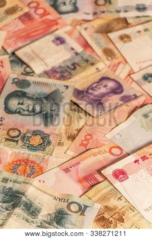 A composition of Chinese Renminbi RMB. Yuan CNY banknotes providing great options to be used for illustrating subjects as business, banking, media, etc. poster