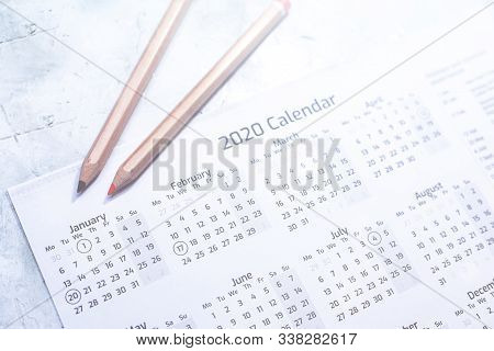 Yearly 2020 Calendar On White Page. Calendar 2020 With Colored Pencils. New Year Planning. 2020 Reso