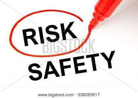 Concept About Choosing To Take A Risk Instead Of Safety. Word Risk Picked With Red Marker Over The W