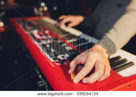 Musician Playing On The Keyboard Synthesizer Piano Keys. Musician Plays A Musical Instrument On The