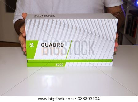 Paris, France - Mar 11, 2019: Curious Man Showing New Nvidia Quadro Rtx 5000 For Workstations Runnin