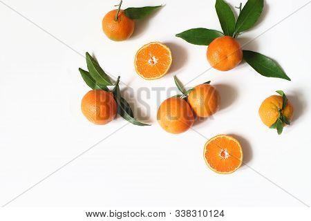Styled Stock Photo. Decorative Summer Fruit Composition. Whole And Sliced Orange Tangerines, Citrus