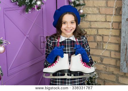 Skating All The Time. Happy Girl With Skates Hanging On Neck. Small Child Enjoy Ice Skating. Figure