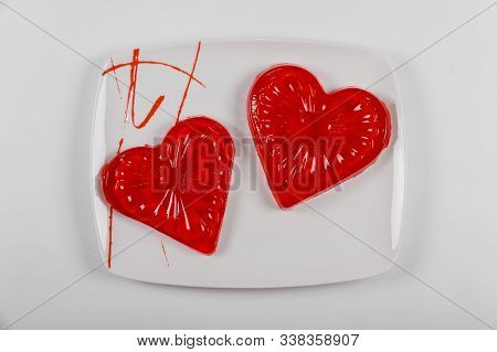 Two Hearts Made From Strawberry Gelatin On White Plate. Wedding Or Valentines Day Concept.