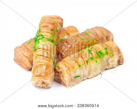 Baklava isolated on white. Dessert originating in the Middle East made of phyllo pastry filled with chopped nuts and soaked in honey