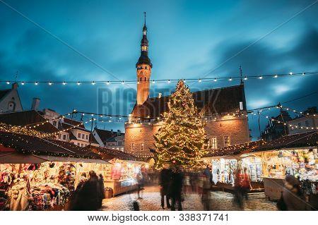 Tallinn, Estonia. Traditional Christmas Market On Town Hall Square. Christmas Tree And Trading House