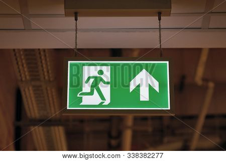 Emergency exit sign glowing in the dark