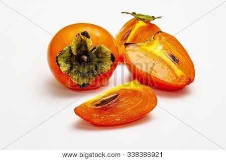 Ripe Single Persimmon. Fresh Whole Fruit, Half Sliced, Seeds. Isolated On White Background