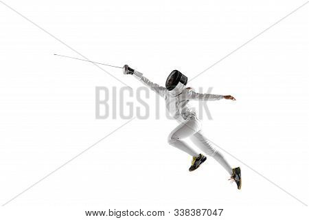 Teen Girl In Fencing Costume With Sword In Hand Isolated On White Studio Background. Young Female Ca