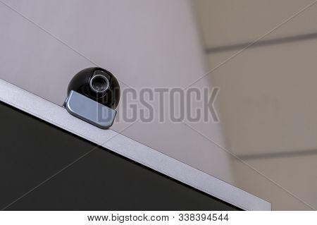 Webcam On A Computer Monitor Against The Ceiling. Copy Space. The Concept Of Online Video Conferenci