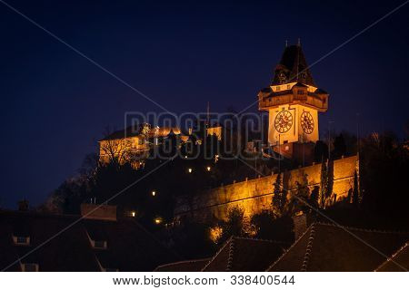 View From City Hall Rathaus To Hill Schlossberg With Landmark Uhrturm In Graz, Styria, Austria