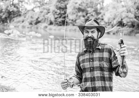 Fisher Fishing Equipment. Rest And Recreation. Fish On Hook. Brutal Man Stand In River Water. Man Be