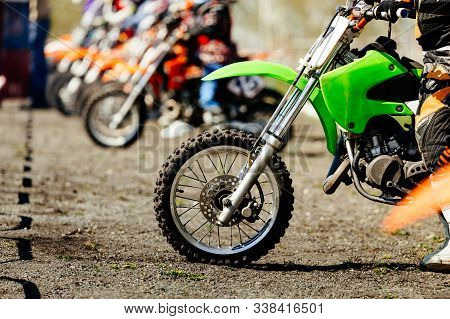 Starting Line Group Motocross Racers On Race Track
