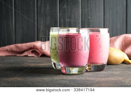 Colorful Smoothie, Fresh Vitamins Drink With Raspberry, Kiwi, Banana And Blueberries. Healthy Detox