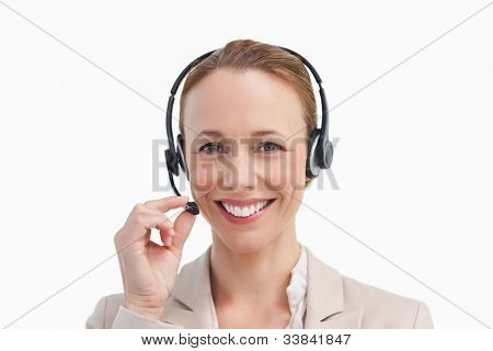 Portrait of a business woman wearing a headset against white background