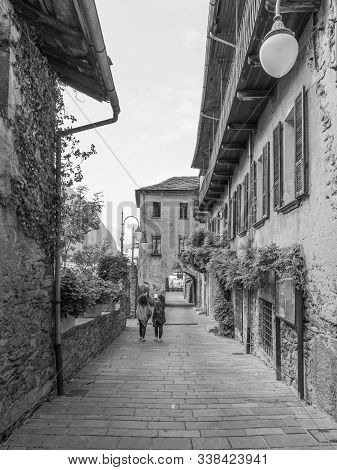 Two Women Stroll In The Medieval Village Of Bard