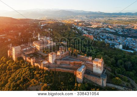 Alhambra aerial view at sunrise with historical buildings in Granada, Spain.