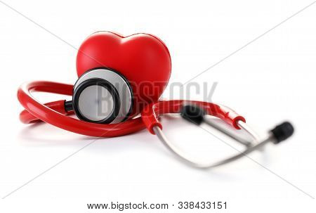 Close-up Of Red Heart And Stethoscope To Listen Patients Respiration. Medical Equipment At Hospital.