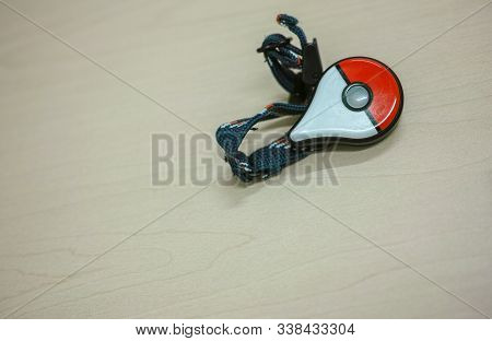 Tokyo, Japan - 24 3 2018: A Pokemon Go Plus Accessory On A Table