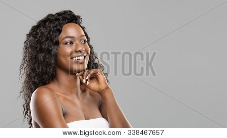 Beauty Concept. Happy Young Attractive Afro Woman With Flawless Skin And Natural Makeup, Looking Asi