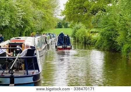 Gledrid, Shropshire, Uk - May 14 2017: A Narrowboat Passing Moored Up Boats On The Llangollen Canal