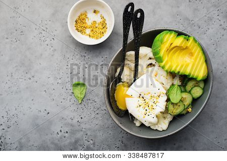 Avocado, Poached Egg, Cauliflower For A Keto Bowl. Plate Of Healthy Food. Top View.