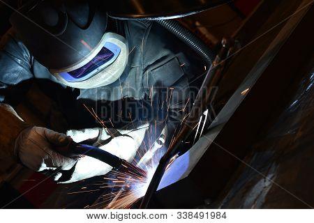 Welding Work. Welder, Craftsman, Erecting Technical Steel Industrial Steel Welder In Factory Technic