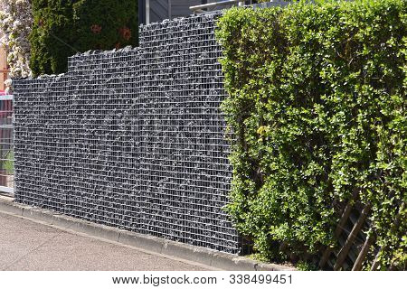 Gabion Fence, Made Of Durable Mesh And Large Stones. European Gabion Fence