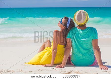 Beach Couple Sitting On White Sand Beach On Romantic Travel Honeymoon Vacation Summer Holidays Roman
