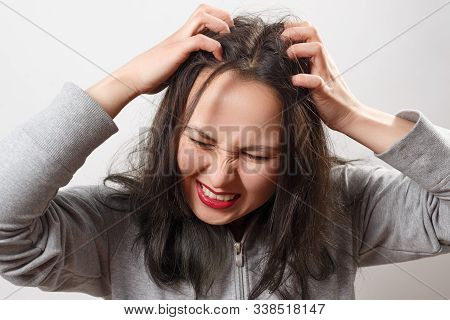 A Young Woman Scratches Her Scalp And Hair With Her Fingers. Hair Health Concept, Scalp And Hair Car