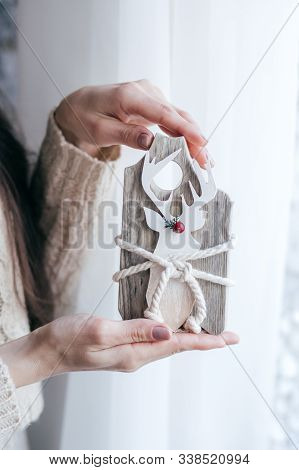 Stock Photo -  Beautiful Girl With Wooden Christmas Rustic Decor