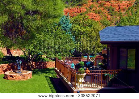 October 17, 2019 In Sedona, Az:  Manicured Landscaping Besides A Cottage With A Spacious Deck Overlo