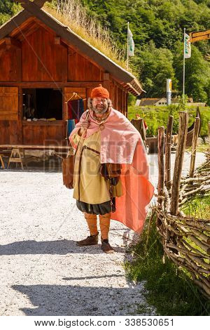 Gudvangen, Norway - June 13 - Traditional Wooden House And Man In National Clothes In The Viking Vil
