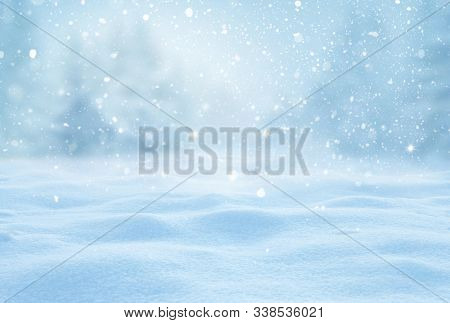 Holidays greeting card with copy-space.Snowy winter landscape with fir trees and snowfall.Winter Xmas  background with snow and blurred bokeh.