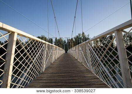 Bridge In Donja Dubrava, Croatia. Hanging White Bridge With Wooden Tread. Low Pov. Attractive Bridge