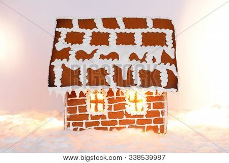 The Hand-made Eatable Gingerbread House With Light Inside And Snow Decoration
