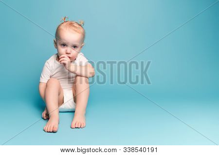 Little Girl Sits On The Floor And Sucks A Finger, Copy Space