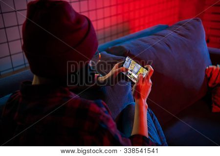 Moscow, Russia - December 6, 2019: Girl Playing Pubg Fps Game On Smartphone. Teenager Into Mobile Ga