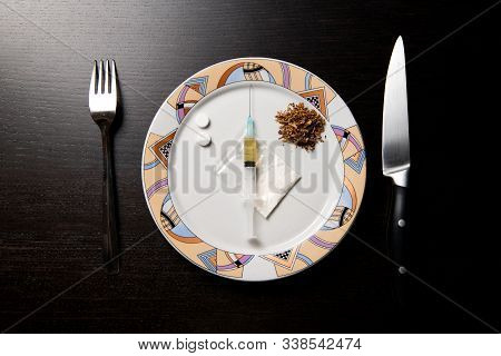 Drugs On A Plate Are Prepared For Consumption. Figurative Image Of Drug Nutrition.
