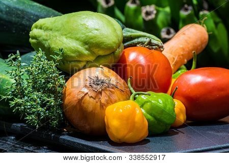 Farm Fresh Food Ingredients Clean And Prepared For Cooking. Colorful Jamaican Vegetables & Spices Fo