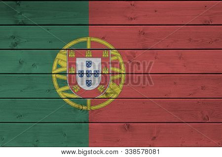 Portugal flag depicted in bright paint colors on old wooden wall. Textured banner on rough background poster